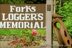 Sign and flowers at the Logger's Memorial in Forks, Olympic Peninsula, Washington