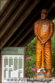 Wooden statue and list of fallen timber workers at the Logger's Memorial in Forks, Olympic Peninsula, Washington