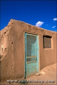 Turquoise door on an adobe house, Taos Pueblo, New Mexico