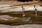 Kids (ages 15 & 12) exploring the low Merced River on the slabs above Vernal Falls, Yosemite National Park, California