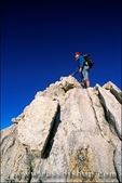 Climber on the summit of Mount Conness, Tuolumne Meadows area, Yosemite National Park, California