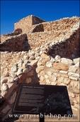 Pueblo rooms and watch tower behind sign describing late pueblo architecture  (Sinagua Indians), Tuzigoot National Monument, Arizona