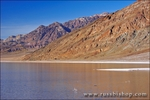 Flooded salt pan at Badwater under the Amargosa Range, Death Valley National Park, California