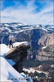 Backcountry skier and Yosemite Falls from Glacier Point, Yosemite National Park, California