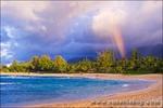 Evening light and rainbow over the Pacific Ocean from Tunnels Beach, Island of Kauai, Hawaii