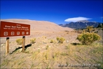 Great Sand Dunes Wilderness sign under dunes and the Sangre de Cristo Mountains, Great Sand Dunes National Park, Colorado