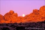 Moonset over granite boulders at dawn, Jumbo Rocks, Joshua Tree National Park, California