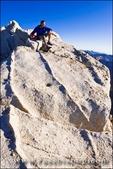 Climber on the summit of Bear Creek Spire, John Muir Wilderness, Sierra Nevada Mountains, California