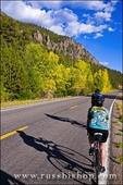 Cyclists passing the Rio Grande Palisades on Highway 149, Rio Grande National Forest, Colorado