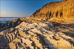 Evening light on rocky coast and surf, Montana de Oro State Park, California USA