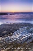 Evening light on rocky coast and surf, Montana de Oro State Park, California USA