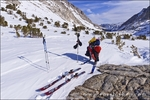 Backcountry skier under Piute Pass, Inyo National Forest, Sierra Nevada Mountains, California