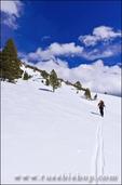 Backcountry skier in the Ansel Adams Wilderness, Sierra Nevada Mountains, California USA