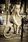 Woman riding a bicycle, Paris, France