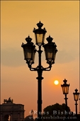 Lamp posts at sunset, Louvre Museum, Paris, France