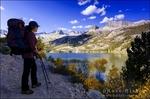 Backpacker on the Bishop Pass Trail at South Lake, John Muir Wilderness, Sierra Nevada Mountains, California USA