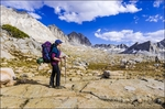 Backpacker on the Bishop Pass trail in Dusy Basin, Kings Canyon National Park, California USA