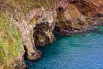 Sea caves along the shore below Cavern Point, Santa Cruz Island, Channel Islands National Park, California USA