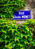 Street sign and ivy covered wall, Giverny, Normandy, France