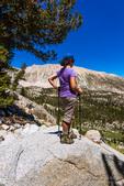 Hiker enjoying the view in the Big Pine Lakes basin, John Muir Wilderness, California USA