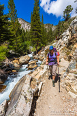 Backpacker on the North Fork of Big Pine Creek, John Muir Wilderness, California USA