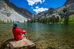 Hiker enjoying the view at Fern Lake, Ansel Adams Wilderness, June Lake, California USA