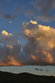 Building Cumulus and a waxing moon at sunset, over the Rincon Mountains. Saguaro National Park East.
