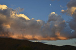 Building Cumulus and a waxing moon at sunset, over the Rincon Mountains, in Saguaro National Park East.