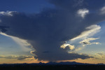 A decaying thunderhead over the Tucson Mountains, late summer afternoon.