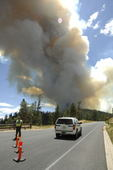 forest fire, Bryce National Park, Utah. Park Ranger stopping traffic