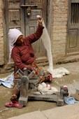 woman spinning wool, Khokana, Nepal