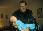 Skokie cop holds a friends baby