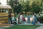 USA,Illinois,Skokie, grade school children line up and board the bus for Fairview school. Children are anglo saxon and of Mexican origin.