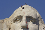Workers repairing cracks in Washington's head, Mt. Rushmore National Memorial, SD