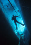 Scuba diver in ice crack