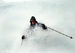 Skier cuts through deep powder
