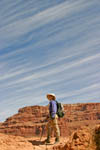 Hiking Along.Hiker makes her way along trail in Havasupai Canyon, one of the 600 side canyons of the Grand Canyon.
