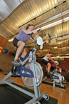 Cycling in class at city gym