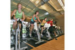 Cycling in class at a city gym