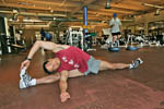 Stretching exercises at a city gym