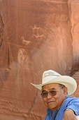 Native man by pictographs