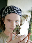 Photo by Yvette Cardozo. Visitor holds Jackson's Chameleon (Chamaeleo jacksoni), at tea plantation outside Nairobi, Kenya, Africa.