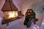 Couple enjoys fire in Quebec Ice Hotel