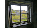 Window view of deserted whaling village, Greenland