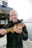 Elated fisherman and his fresh caught cod
