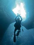 Scuba diver in cavern in Palau, Micronesia.