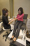 Manicurist prepares hands of client for manicure
