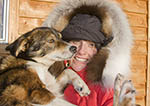 Dogsled musher Julie Estey and one of her racing dogs