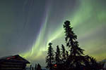 The aurora (northern lights) folds in the sky above Chena Hot Springs