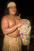 Local native, a member of the Maleku tribe displays drum with carved wood.